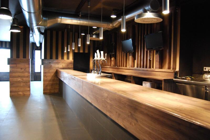 Tuespacio stands rotulaci n instalaci n comercual for Fabricacion de bares de madera